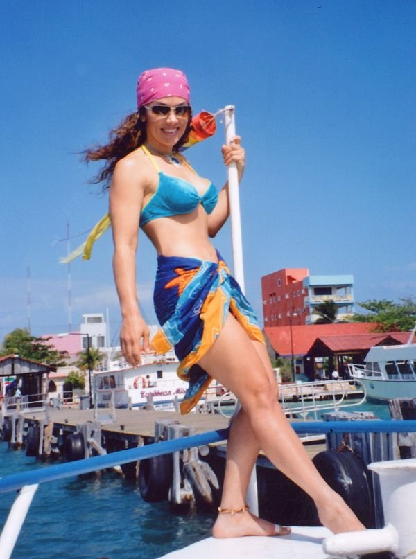 [In bikini on boat] ...